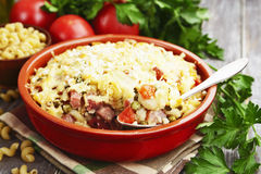 Baked pasta with bacon and green peas Stock Photography