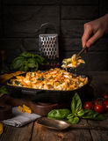 Baked pasta with broccoli, cauliflower, cheese and bechamel sauc Stock Images