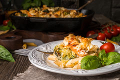 Baked pasta with broccoli, cauliflower, cheese and bechamel sauc Royalty Free Stock Photography