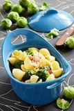 Baked pasta with brussels sprouts. Stock Image