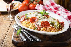 Baked pasta with cheese and pepperoni. Baked pasta with cheese, green pepper and pepperoni royalty free stock photography