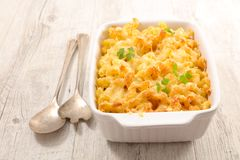 Baked pasta and cheese. On table Royalty Free Stock Image