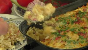 Baked pasta with ham and eggs stock video footage