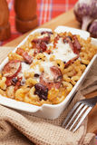 Baked pasta. Italian style baked pasta with bacon, sausage and melted cheese Royalty Free Stock Photo