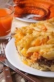 Baked Pasta with meat and pumpkin and vegetable juice. vertical Royalty Free Stock Image