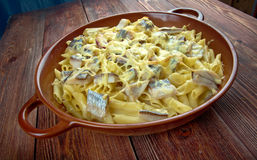 Baked pasta penne with mackerel Stock Photos