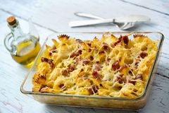 Baked pasta with smoked meat Stock Photo