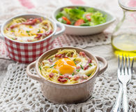 Baked pasta spaghetti carbonara with egg yolk, cheese and bacon Stock Photography