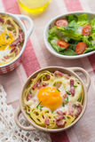 Baked pasta spaghetti carbonara with egg yolk, cheese and bacon Stock Photo