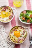 Baked pasta spaghetti carbonara with egg yolk, cheese and bacon Royalty Free Stock Images
