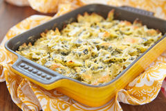 Baked pasta with spinach Stock Images