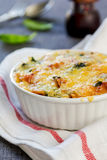 Baked pasta with spinach in tomato sauce Stock Photo