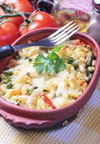 Baked pasta with vegetables. Oven baked pasta with vegetables, traditional italian recipe Royalty Free Stock Photos