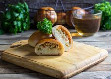 Baked patties stuffed with cabbage. Stock Photography