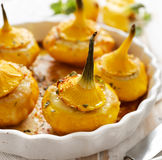 Baked Pattypan squash , stuffed with cheese Royalty Free Stock Images