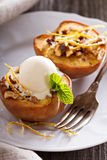 Baked peaches with ice cream Stock Photography