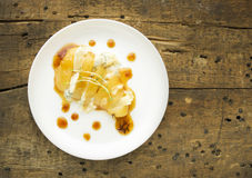 Baked pear with caramel and cheese Stock Photography