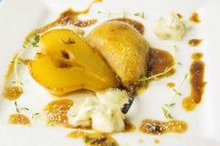 Baked pear with caramel and gorgonzola Royalty Free Stock Photo