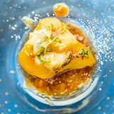 Baked pear with caramel, gorgonzola and thyme Stock Photo