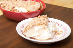 Baked pear with honey, cinnamon, brown sugar, ricotta cheese and Royalty Free Stock Photos