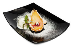 Baked Pear with Ice Cream Stock Photo