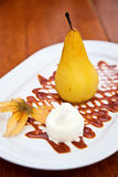 Baked Pear With Ice Cream Royalty Free Stock Images