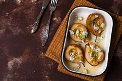 Baked pears with nuts. And blue cheese. Selective focus Stock Images