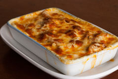Baked penne pasta with tomato sauce and cheese Stock Images