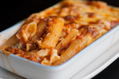Baked penne pasta with tomato sauce and cheese Stock Photos