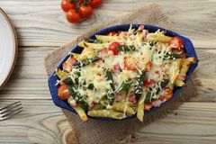Baked penne rigate with tomatoes, asparagus, ham and cheese Royalty Free Stock Photo