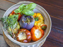 Baked peppers stuffed with goat and lamb cheese Stock Photo