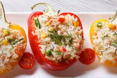 Baked peppers stuffed with rice, vegetables and meat top view Stock Image
