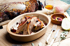 Baked pheasant. With bacon, pear, raisins on brandy Royalty Free Stock Photography