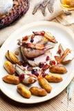 Baked pheasant. With bacon, pear, raisins on brandy Royalty Free Stock Photos