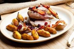 Baked pheasant. With bacon, pear, raisins on brandy Stock Photo