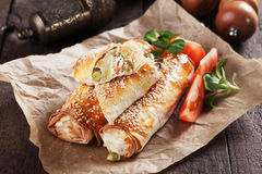 Baked phyllo pastry rolls Royalty Free Stock Image