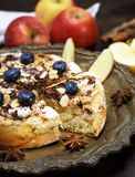 Baked pie with apples on an iron plate. Baked with blueberries Stock Images
