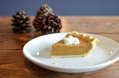 Baked Pie With Topping On White Ceramic Plate Near Brown Pine Cones Stock Photography