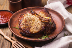 Baked pieces of pork in a clay plate Stock Images