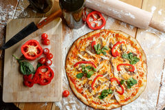 Baked pizza with chicken and paprika and ingredients. Italian traditional food Royalty Free Stock Photos