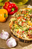 Baked pizza and fresh pepper Stock Photos