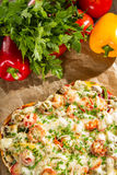 Baked pizza and fresh vegetables Royalty Free Stock Photos