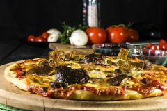 Baked pizza homemade with cheese and wild mushrooms stock images