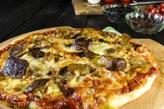 Baked pizza homemade with cheese and wild mushrooms stock photo