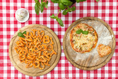 Baked pizza letters and pizza Royalty Free Stock Photography