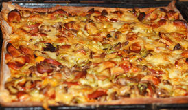 Baked pizza from oven Royalty Free Stock Image