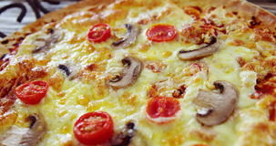 Baked pizza on pan stock video footage