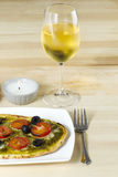 Baked pizza with wineglass on table Royalty Free Stock Photo