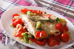 Baked plaice with seasonal vegetables close-up on a plate Royalty Free Stock Image