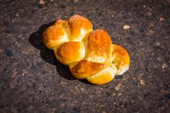 Baked plaited crispbread crispy on a wooden table royalty free stock photo
